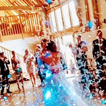 Bruisyard Hall married couple share first dance under white confetti.