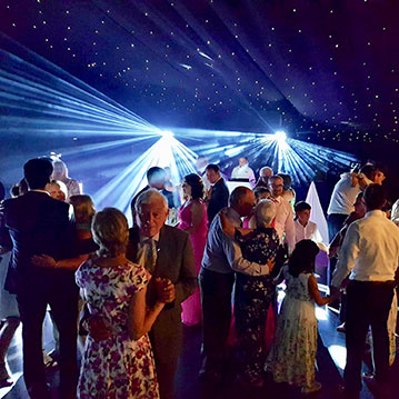 Chippenham Park disco lighting during evening wedding DJ set.